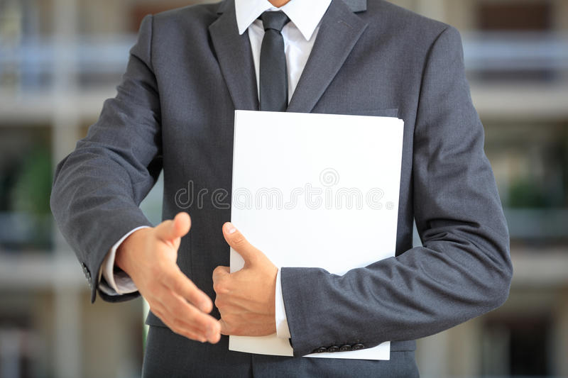 Manager offering a handshake royalty free stock photos