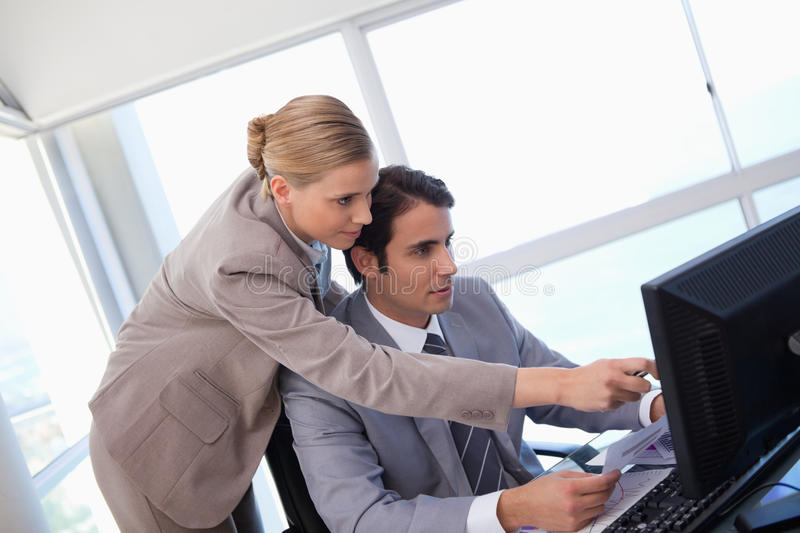 Manager pointing at something on a computer royalty free stock photography
