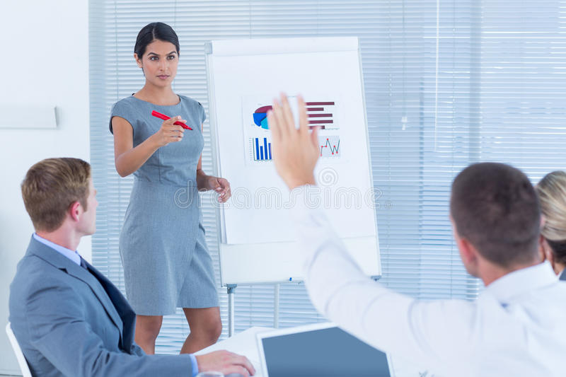 Manager presenting statistics to her colleagues stock photo