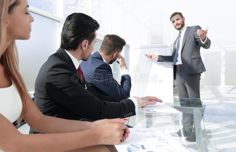 Manager presents a new project for business partners royalty free stock images