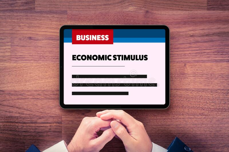 Manager read about economic stimulus after crisis stock photo