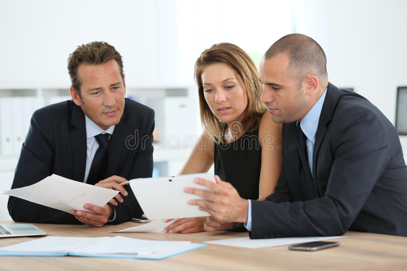 Manager with sales people using tablet royalty free stock image