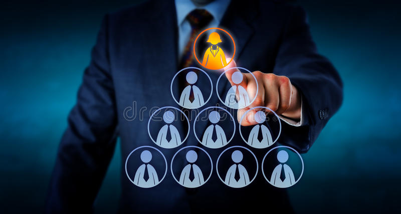 Manager Selecting A Female Worker Atop A Pyramid. Torso of a human resources manager is selecting a female office worker atop a pyramid made out of otherwise royalty free stock images