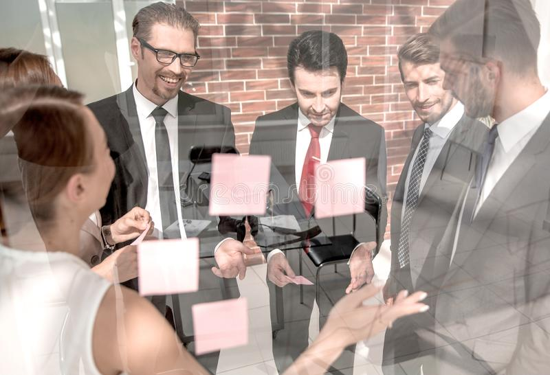 Manager shows business team business notes stock photos