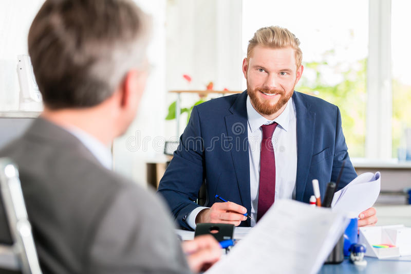 Manager signing documents at the office royalty free stock photo