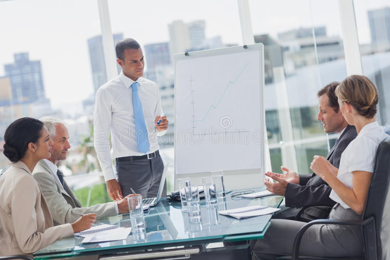 Manager Standing In Front Of Colleagues Royalty Free Stock Photography