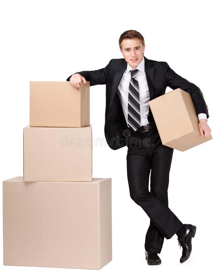Manager stands near pile of cardboard boxes royalty free stock image