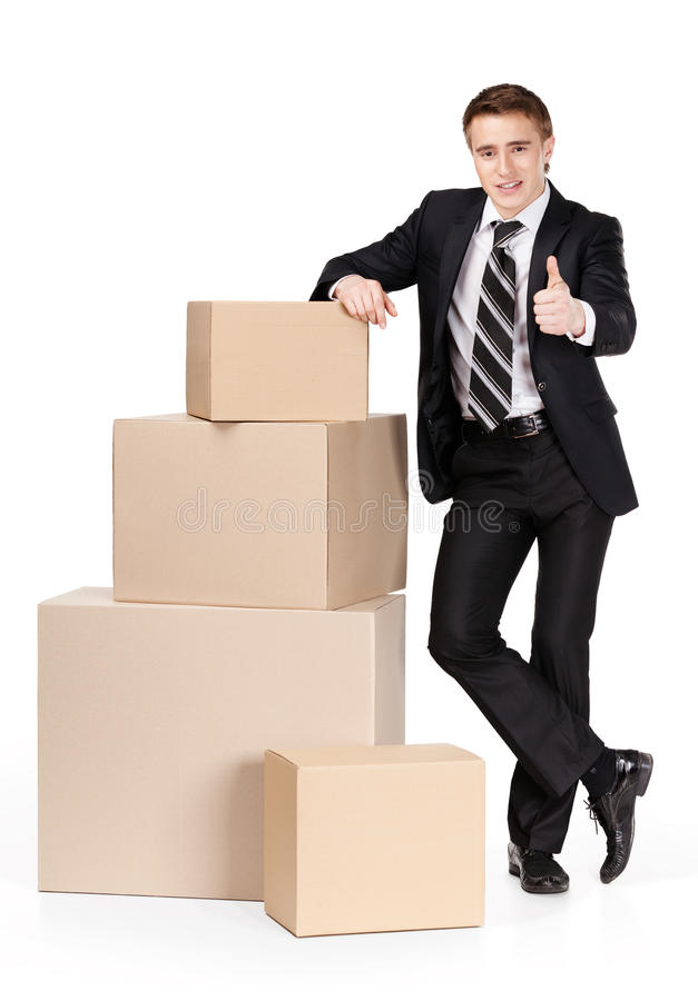 Download Manager In Suit Stands Near Pile Of Containers Stock Photo - Image: 26880458
