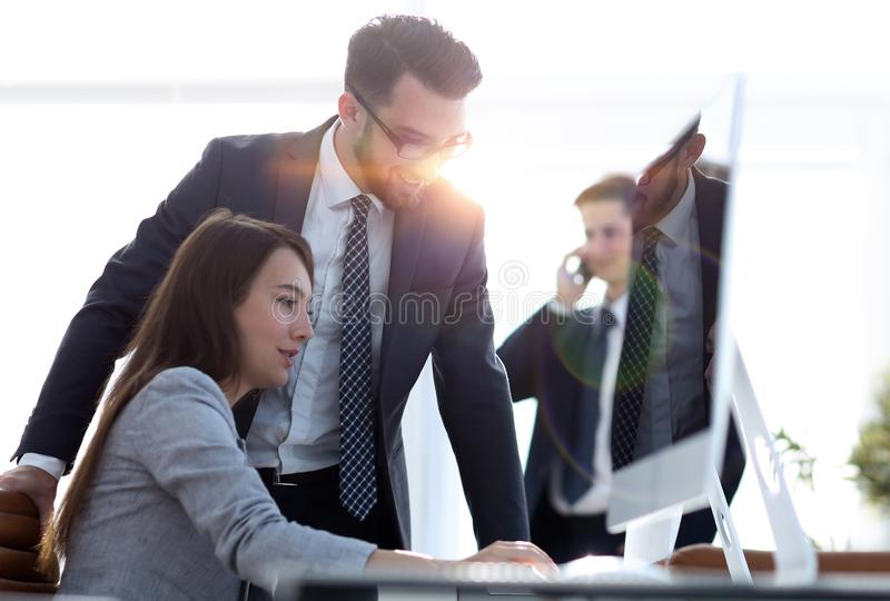 Manager talking with an employee stock image