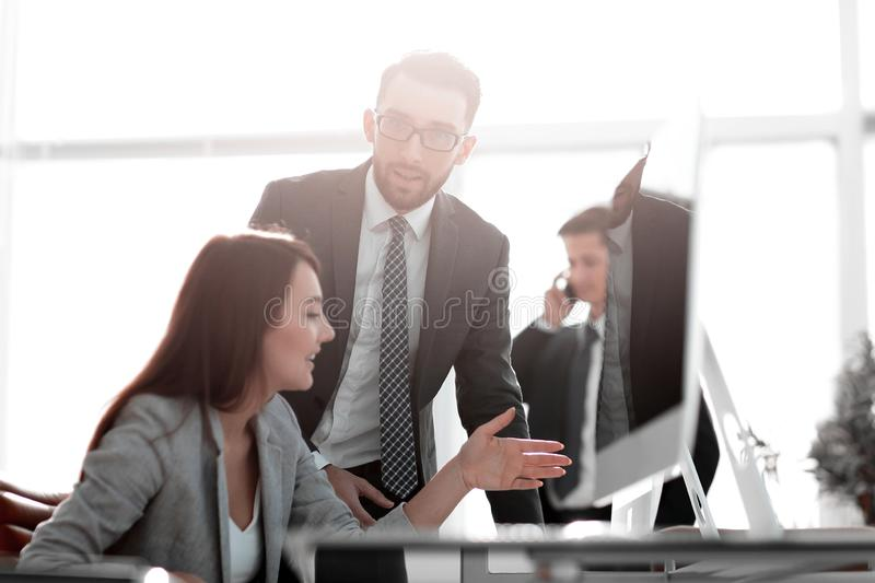 Manager talking with an employee royalty free stock images