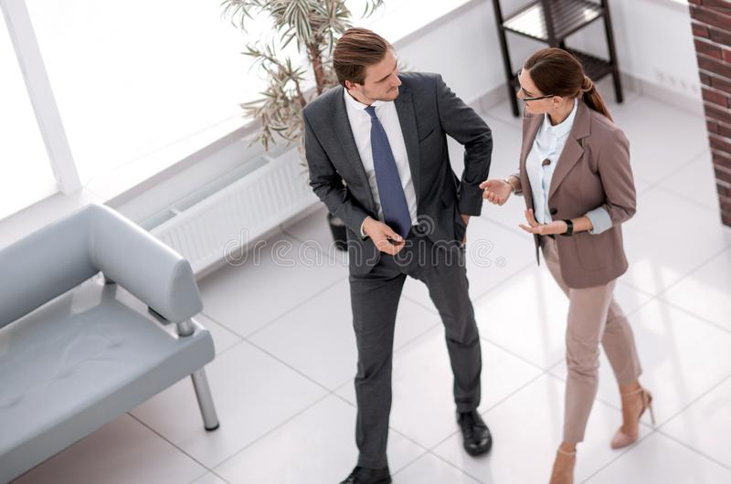 Manager talking to an employee in the office lobby stock photos