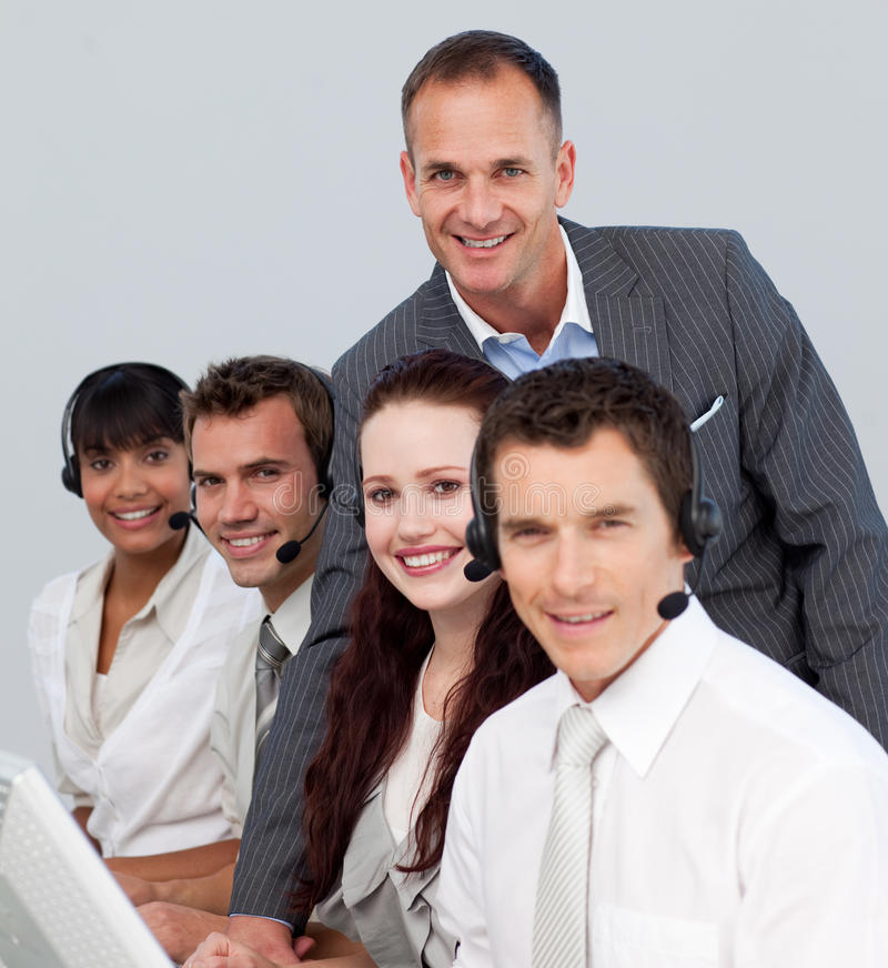 Manager talking to his team in a call center stock image