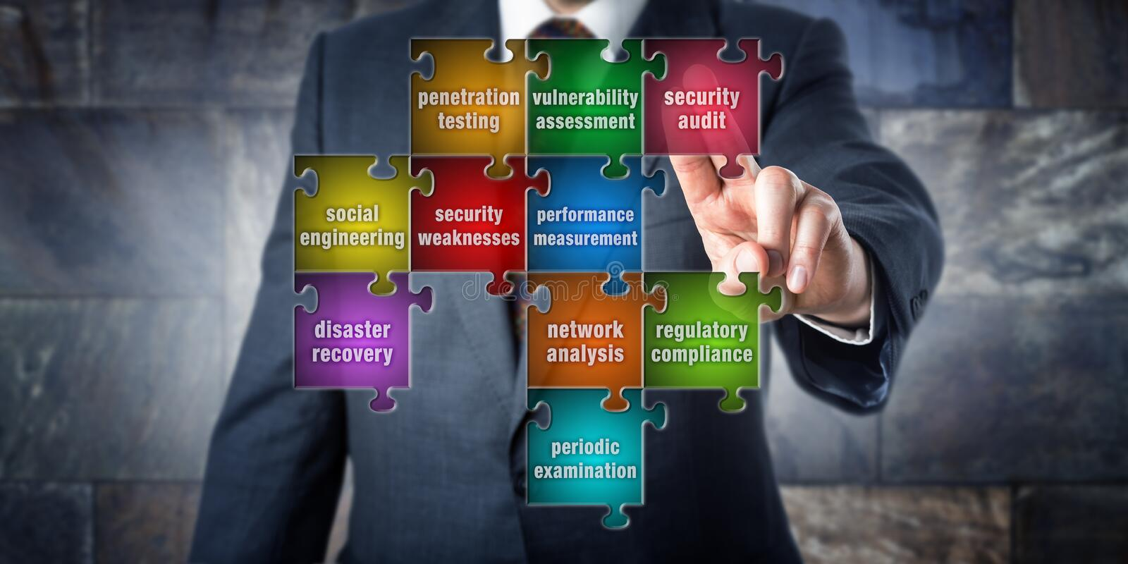 IT Manager Touching Security Audit In A Puzzle. IT manager is doing a virtual puzzle made of pieces labeled with security audit terminology. Information systems
