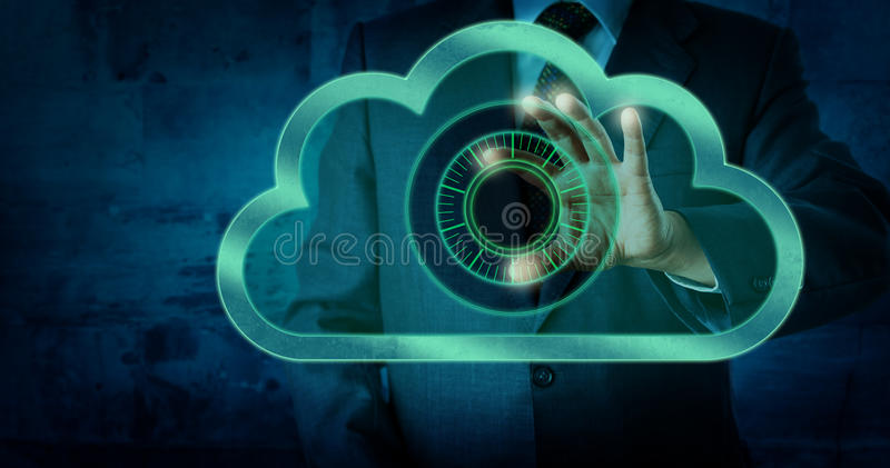 Manager Touching Virtual Dial Lock In The Cloud. Torso of a manager is touching a dial lock in the cloud. Finger tips of his thumb and index finger are operating stock photo