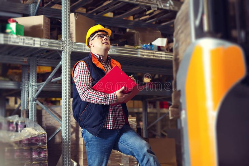 Manager In Warehouse With Clipboard close-up picture royalty free stock image