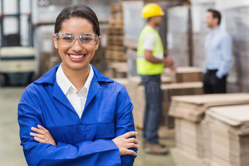 Manager wearing protective mask looking at camera stock images