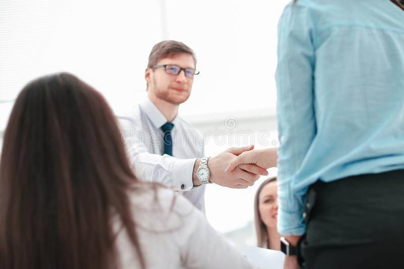 Manager welcomes the project Manager before the meeting stock photos