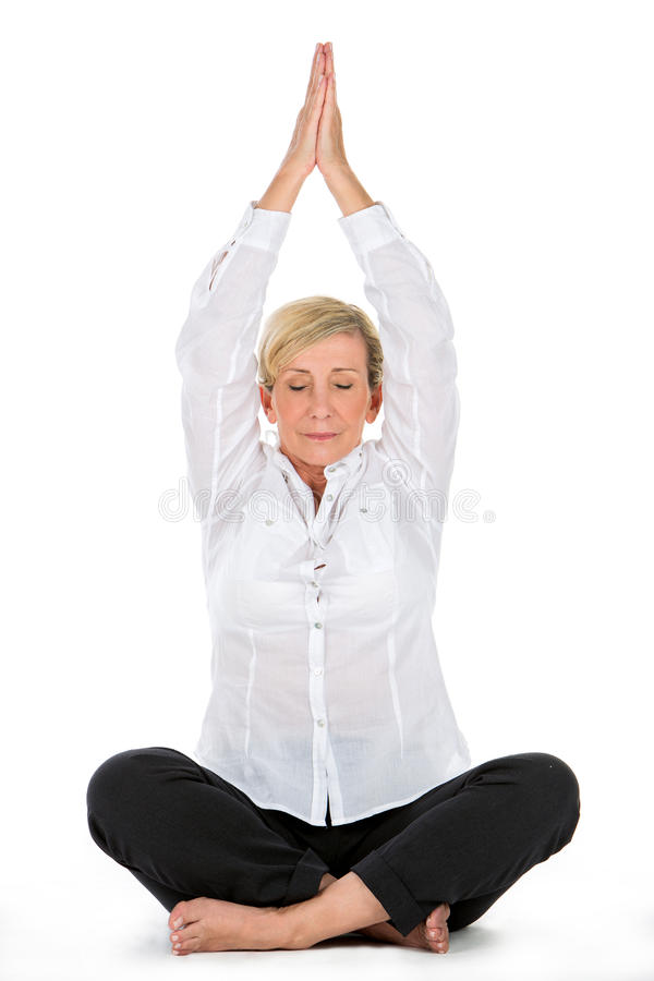 Manager woman doing yoga at white background royalty free stock images