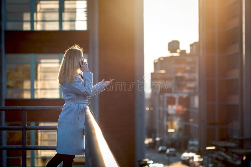 Manager woman using her smartphone stock images