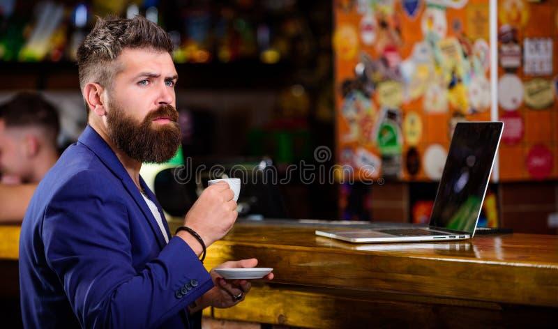 Manager work online while enjoy coffee. Online job. Hipster freelancer work online blog notebook. Freelance benefit. Surfing internet. Man bearded businessman stock photos