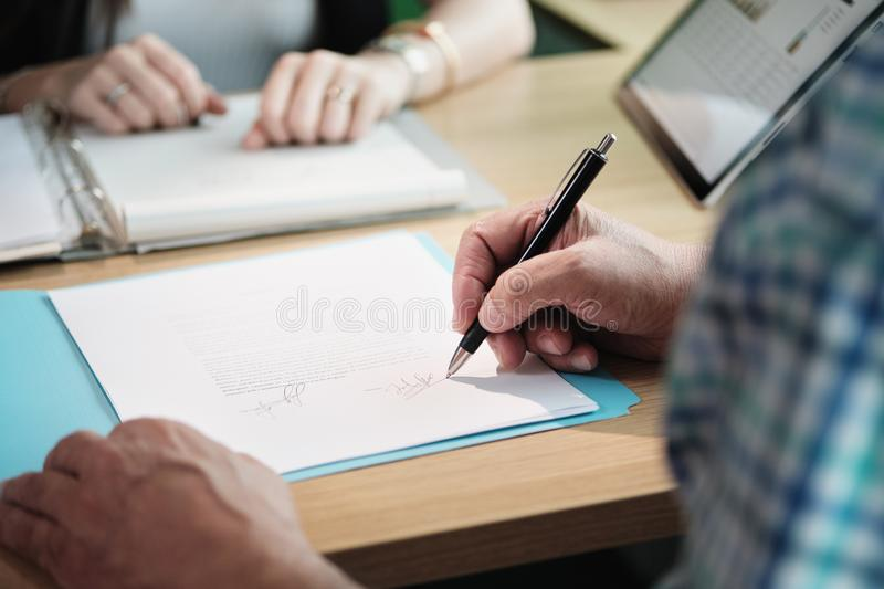 Manager Working As Banking Broker With Old Man Signing Contract stock photography