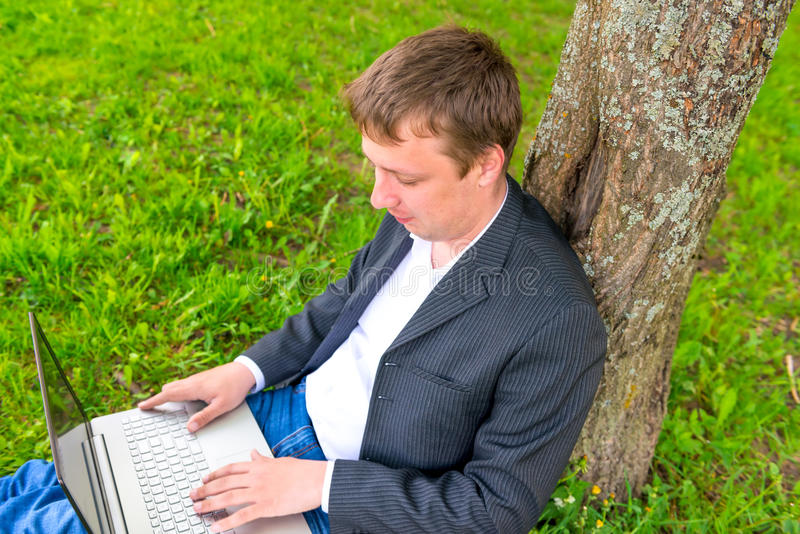 Manager works on the nature. Of the computer royalty free stock photos