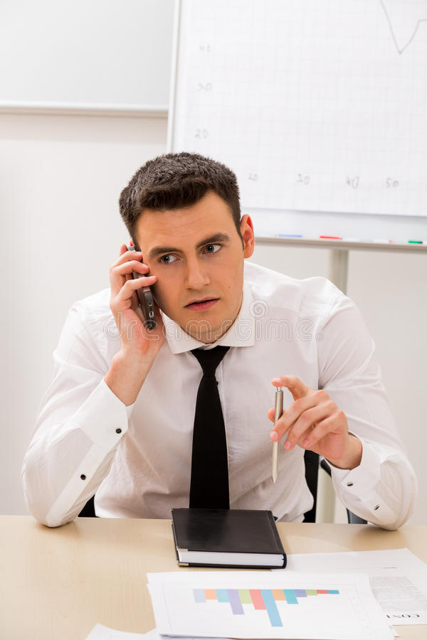 Manager works in the office. Clerk in the office said by telephone. Manager works in the office stock photo