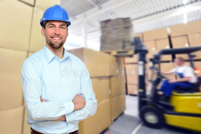 Manager works on-site in the warehouse of an industrial company. Closeup royalty free stock images