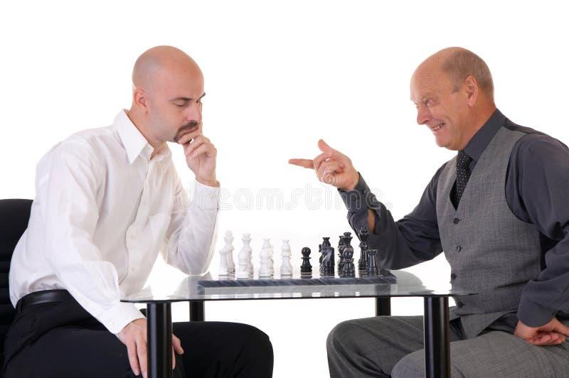 Managers die schaak spelen stock foto's