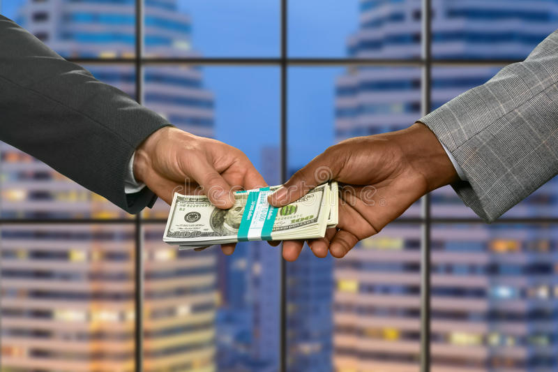 Managers pass money in megalopolis. Businessman repays debt in office. Managers pass money in megalopolis. Money rules the world. The path takes strange turns royalty free stock photography