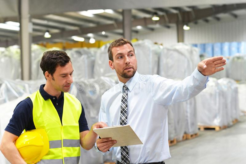 managers and workers in the logistics industry talk about working with chemicals in the warehouse stock photos
