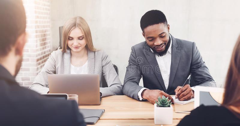 Managers working in office, using laptop and writing ideas stock photo
