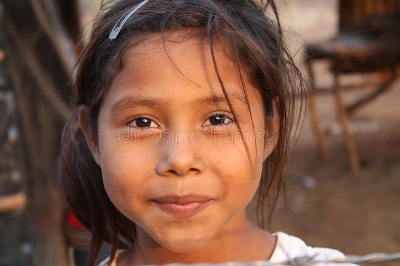 Portrait of a young girl in Nicaragua smiling while playing stock photography
