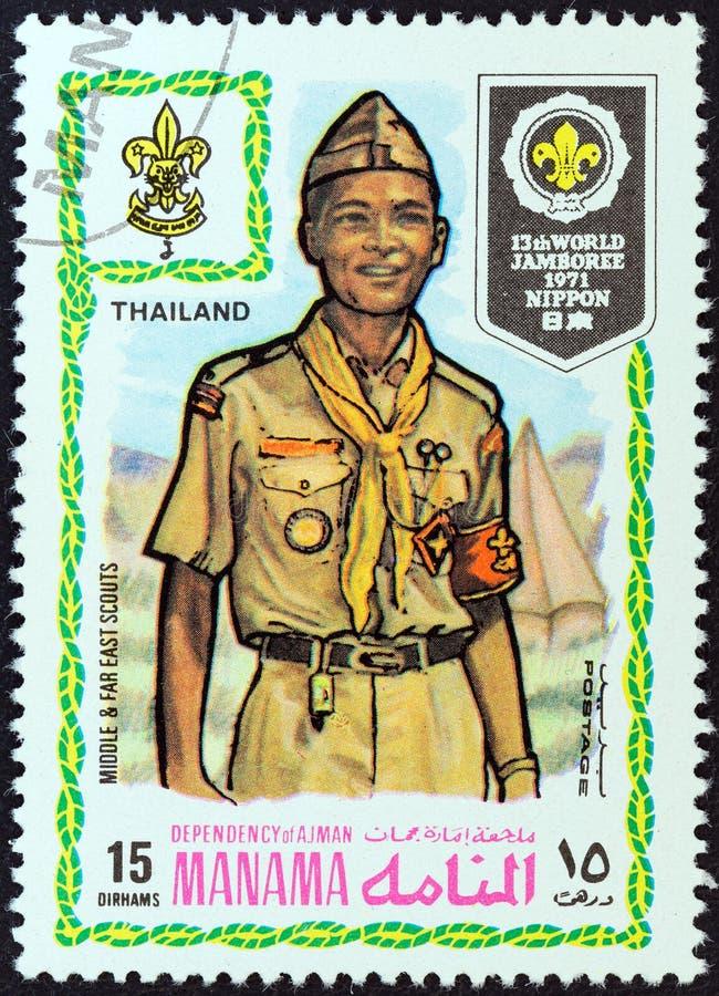 MANAMA-ABHÄNGIGKEIT - CIRCA 1971: Ein Stempel, der in Arabische Emirate gedruckt wird, zeigt Pfadfinder von Thailand, circa 1971 stockfoto
