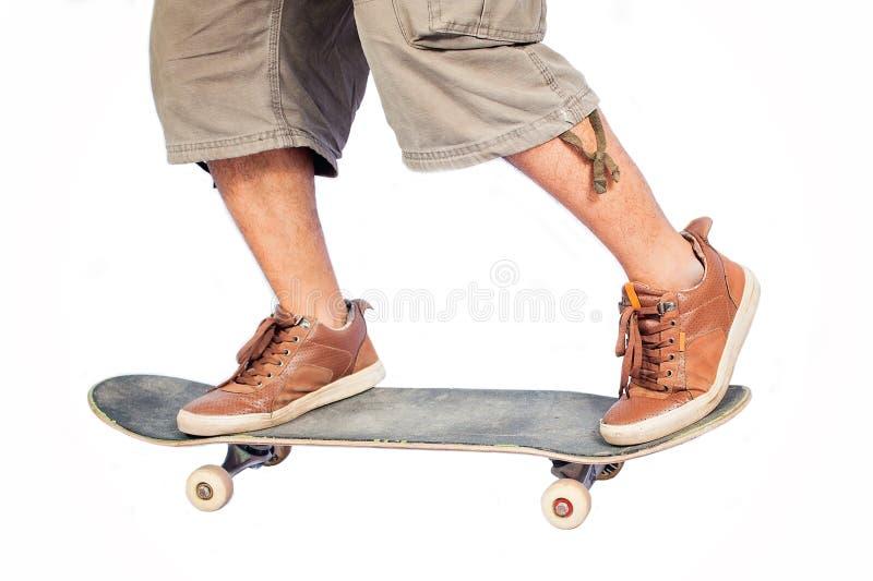 Mananseende på en skateboard arkivfoto