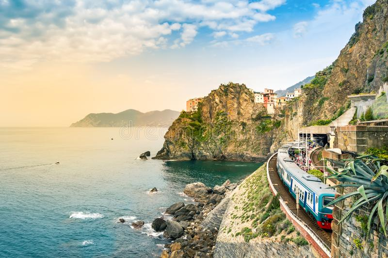Manarola, Cinque Terre - train station in famous village with colorful houses on cliff over sea in Cinque Terre royalty free stock photography