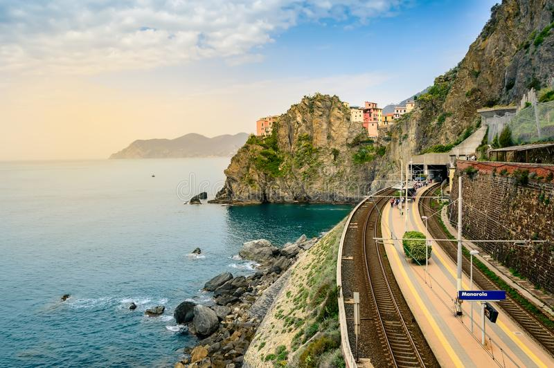 Manarola, Cinque Terre - train station in famous village with colorful houses on cliff over sea in Cinque Terre stock image
