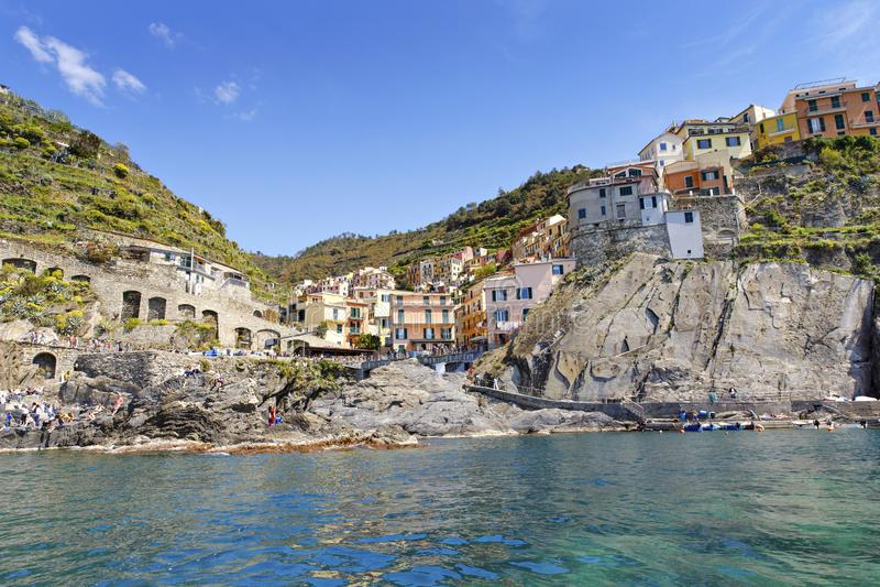Manarola, Liguria, Italy fisherman village, colorful houses on sunny warm day. Monterosso al Mare, Vernazza, Corniglia royalty free stock photo