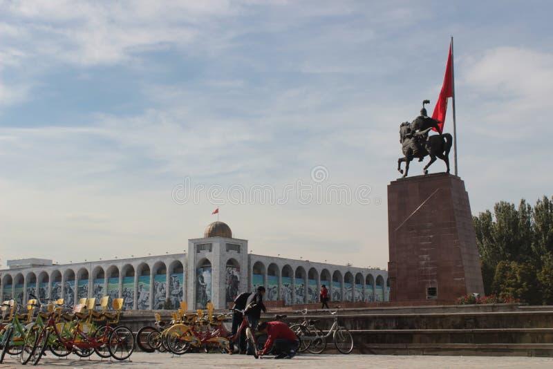 Manas statue in Bishkek, Kyrgyzstan, bicycle rental royalty free stock photography