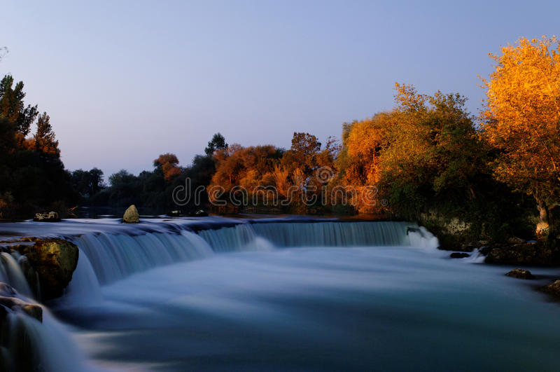 Manavgat waterfall. Scenic view of Manavgat waterfall with Autumnal forest in background, Antalya, Turkey stock photo