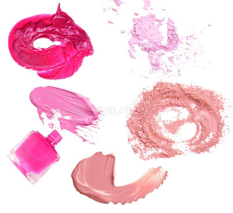 Mancha del pulidor y del labio del clavo del polvo del maquillaje aislada en blanco fotos de archivo