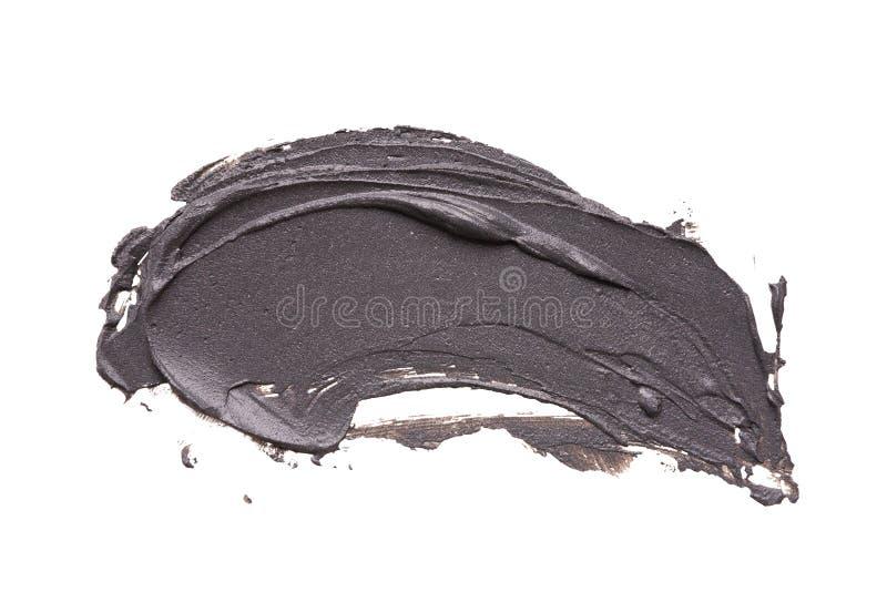 A mancha facial da máscara da argila preta no branco isolou o fundo fotos de stock royalty free