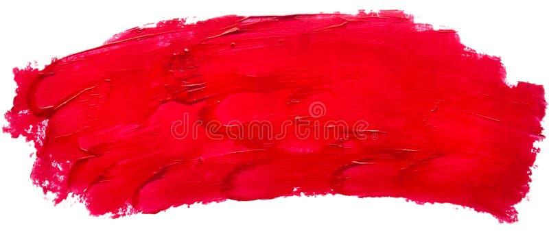 Mancha y textura de la barra de labios o de la pintura acrílica roja aislada en el fondo blanco con el espacio de la copia foto de archivo libre de regalías