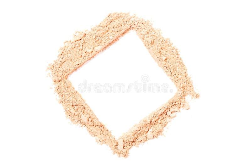 Manchas beige ligeras del polvo de cara en el fondo blanco fotos de archivo libres de regalías