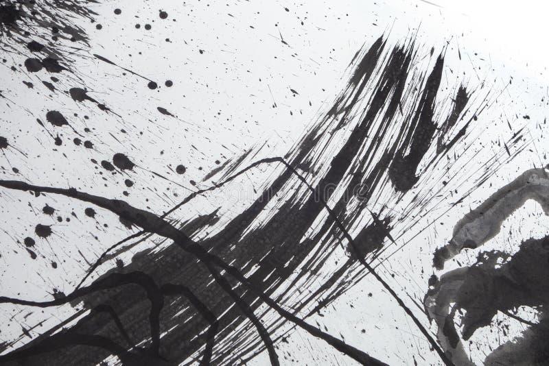 Manchas y splats negros de la tinta del Grunge en el Libro Blanco foto de archivo