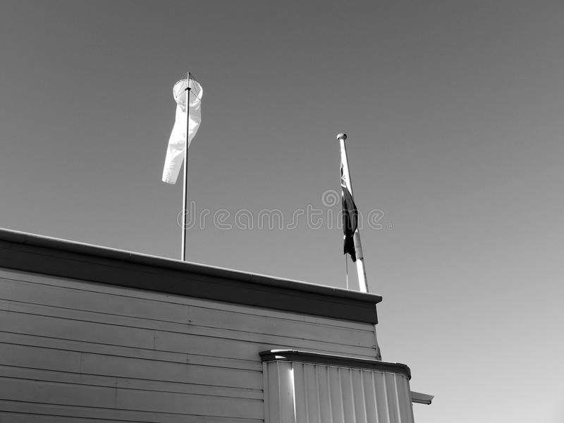 Manche à air et mât de drapeau photo stock