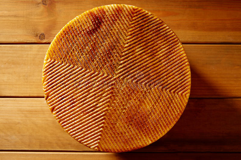 Manchego cheese from Spain in wooden table. Texture detail stock photography