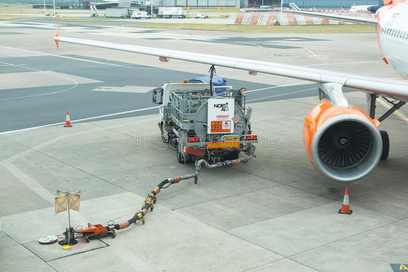 Easyjet Airbus A319-111 aircraft being refueled at Manchester airport terminal royalty free stock photos