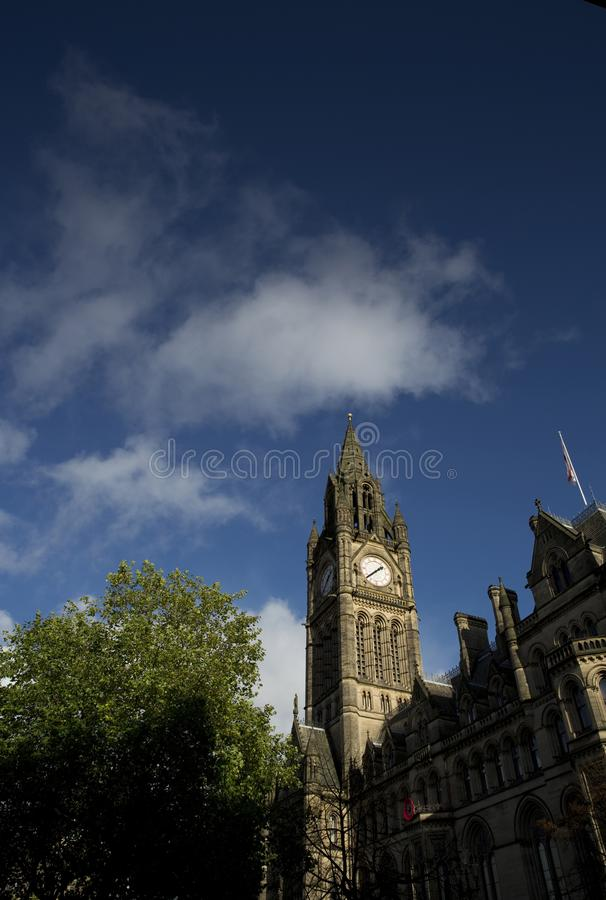 Manchester Town Hall in Albert Square against a blue sky. Manchester, UK - 29th October 2013 royalty free stock photography
