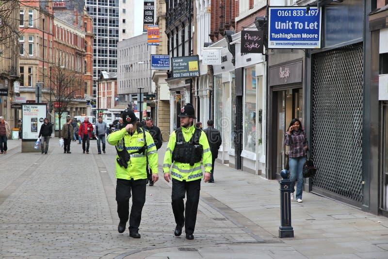 Manchester UK. MANCHESTER, UK - APRIL 22, 2013: Police officers patrol streets of Manchester, UK stock image